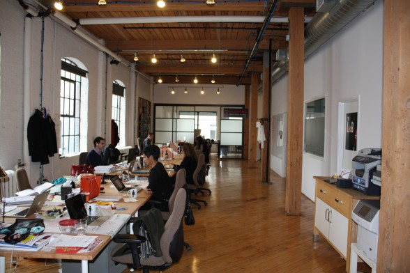 Lots of collaboration, communication and teamwork, and you can tell their workspace is designed to make that happen.
