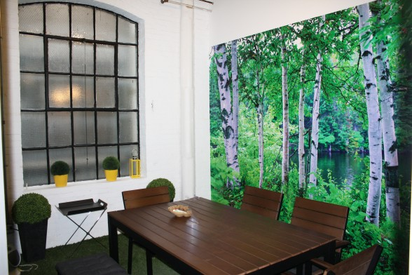"""Public lets you work outside-well, almost. All their meeting rooms are unique, like the """"Cabin"""" complete with grass astroturf and benches."""