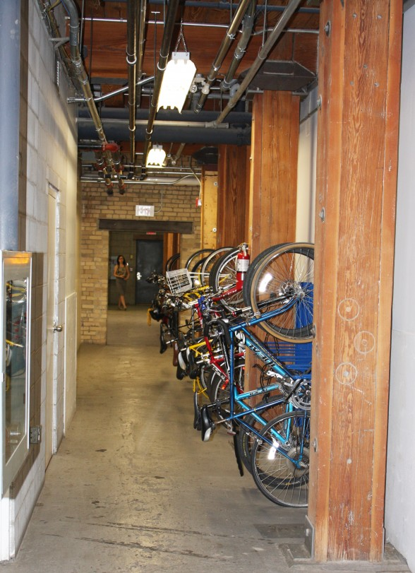 Employees park their bikes in the shared bike locker in the basement.